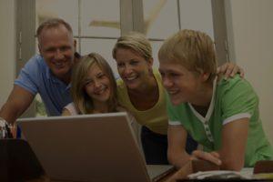 Happy family uses Swap-Swap on laptop